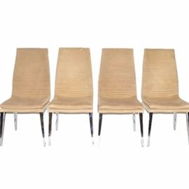 Four Modern Style Suede Chairs by Smania: A collection of four Modern style suede dining chairs by Smania of Venice, Italy. Each chair is covered in tan suede and rises up on four tapering metal legs. The manufacturer's logo is patterned to the underside of each chair.