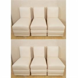 High Back Dining Chairs: A collection of six high back dining chairs. Each chair has a fully upholstered body with rolled crest and full apron. The chairs include casters and are upholstered in a cream hue.