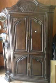 One of a pair of armoires, part of a set with a king size headboard, one nightstand, we will sell pieces separately