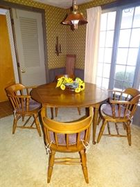 Dinette set with four chairs, two leaves & pads.