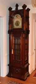 This is a remarkable and extraordinary Clock by Inspire.  It has been thoroughly reviewed by a clock specialist and is in full working order, mint case, with beautiful Gothic carvings.  Truly one of a kind..