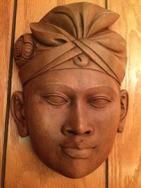 "Pair of heavy carved wooden ""African"" masks"