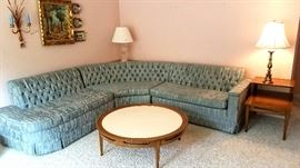 Three piece sectional in pristine condition.  Step end table & unique coffee table.  Plus wall hangings