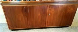 Walnut cabinet has storage on left & liquor cabinet on right that swings out.