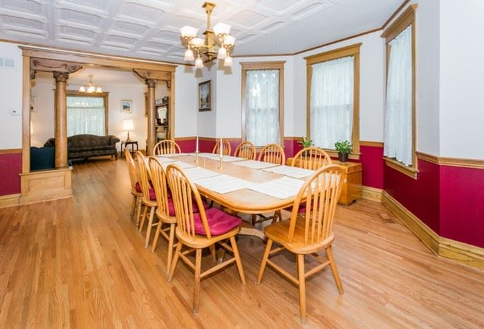 """Large Oak dining table.  Shown here with two leaves.  Dimensions with the leaves: 111"""" x 48"""".  Table with no leaves is 69"""" x 48"""""""