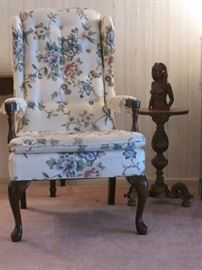 Floral Armchair. Tables and Carvings.