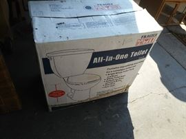 Toilet with tank still in box
