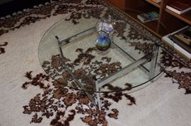 Glass coffee table on rug.