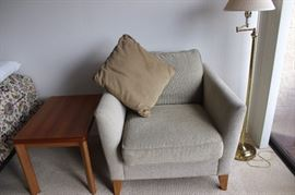 Armchair that matches the couch, one of two matching end tables.