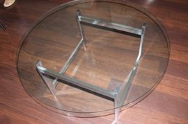 Round glass and chrome coffee table.