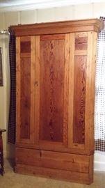 Old handmade curly pine wardrobe.