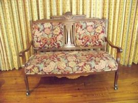 Walnut Victorian full size settee in impeccable condition with gorgeous upholstery