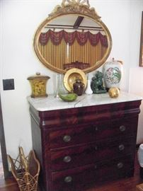 Gorgeous early flame and crotch mahogany marble top chest