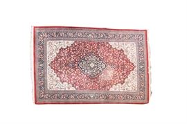 Persian Rug: A Persian area rug. This wool rug features an all over floral, foliate and vine pattern, with fringe ends, and hues of orange, cream, rust and more.