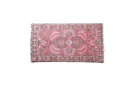 """Bashiran Hand Woven Persian Wool Rug: A Bashiran hand woven wool rug. This rug features an all over floral and foliate pattern, in hues of crimson, blue, taupe, pink, and orange. A tag is present to the verso """"Bashiran Genuie Oriental rugs – Super Lilahan Kanape, Made in Persia""""."""