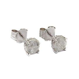 14K White Gold Diamond Stud Earrings: A pair of 14K white gold diamond stud earrings.