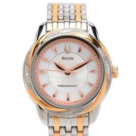 Bulova Precisionist Diamond Stainless Steel Wristwatch: A Bulova Precisionist two-tone stainless steel wristwatch with diamonds adorning the bezel.
