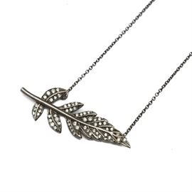Oxidized 18K White Gold Diamond Necklace by Coletti: An oxidized 18K white gold diamond necklace by Coletti. The pendant feature a leaf or feather motif with diamond accents.
