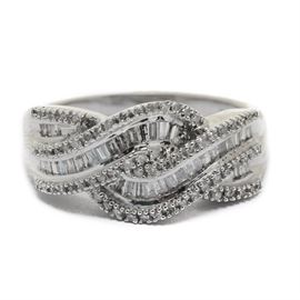 10K White Gold Diamond Baguette Swirl Ring: A 10K white gold diamond swirl ring featuring channel set baguettes with prong set diamond accents.