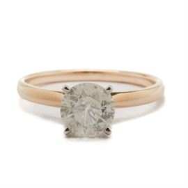 14K Yellow Gold 1.40 CTS Diamond Solitaire Engagement Ring: A 14K yellow gold diamond solitaire engagement ring. This ring features a 1.40 cts diamond in a four prong setting.