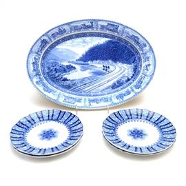 """English Staffordshire Transferware China: A grouping of English Staffordshire, transfer decorated china, to include: four dessert plates with blue medallion and striped decorated border, marked """"Cauldon England""""; together with a blue oval platter, having a railroad scene of """"Indian Creek"""". The bottom is marked, """"Baltimore and Ohio Railroad, Scammel's Lamberton China"""""""