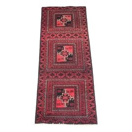 Semi-Antique Hand Knotted Karajeh Heriz Runner: A semi-antique hand knotted Karajeh Heriz runner. This wool rug features three hooked cruciforms surrounded by compound borders with rams horn design. Oak leaves are present between the medallions and as the major border with a minor running water border in this burgundy, black and cream rug. This runner ends in a short, white cotton fringe and is unsigned.