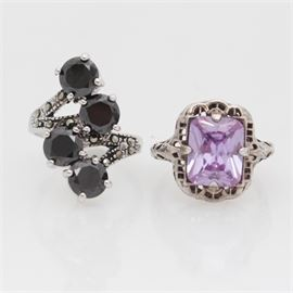 Sterling Silver Ring Pair: A pair of sterling silver and synthetic gemstone rings.
