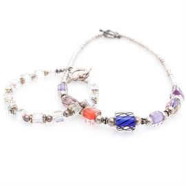 Sterling Silver Crystal and Glass Jewelry: A sterling silver crystal bead bracelet and sterling silver glass bead necklace.