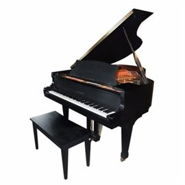 Kawai RX-2 Classic Grand Piano: A Kawai Classic Grand Piano, model RX-2, with a black lacquer finish, brass pedals and casters, and matching bench which opens for storage.