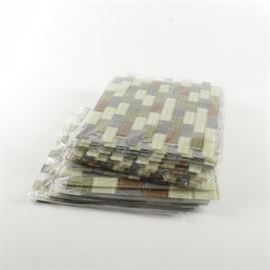 Packs of Decorative Mosaic Tiles: A group of Premium Mosaic tile packs, eighteen in total. These tiles consist of grey, cooper, light green, and a darker green color. The tiles also appear to have a small amount of translucent quality.