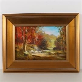 """James M. Sulkowski 2012 Oil Painting of a Landscape """"Autumn Woods"""": A 2012 oil painting of a landscape on board titled Autumn Woods by listed American artist James Sulkowski (Pennsylvania; born 1951). This softly-rendered piece depicts groups of orange- and red-leafed trees on the banks of a slow-moving creek. The scene is seen in a warm autumn light, with the clouds in the sky captured in a cool shade of pink. This painting is signed and dated """"'12"""" to its lower left corner, and is presented in a wide gold tone frame with a wire to its verso for hanging."""