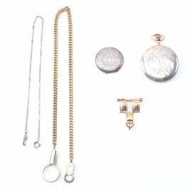 """Sterling Silver and Gold Tone Vintage Pocket Watch Parts: An assortment of sterling silver and gold tone vintage pocket watch parts. The assortment includes two watch fobs, a lapel pin watch holder, a pocket watch case, and a pocket watch case back. The pocket watch case features a pictorial engraving highlighting a house in the distance, accented by rose gold and yellow gold tone floral and scroll work details, and displays a hallmark on the case back reading """"Illinois W. C. CO. Elgin 823395"""". Also included in this assortment is a sterling silver pocket watch case back which features an engraved filigree style pattern. The pocket watch case and case back are hallmarked as or tested as sterling silver and the total approximate weight of the pair is 1.090 ozt."""