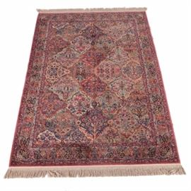 """Machine Made Karastan """"Kirman"""" Style Area Rug: A machine made Kirman wool area rug by Karastan. This American-made rug features a floral Persian-style panel pattern with pink, red, navy blue and light tan grounds. The main border has a light blue ground with florals in red, pink, orange and yellow, among other colors. Selvedges are overcast, while ends feature applied fringe. Not marked."""