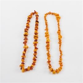 Amber and Mutton Fat Beaded Necklaces: A pairing of amber and mutton fat beaded necklaces. This assortment features polished tumbled free form beads of mutton fat and amber. One necklace features an alternated pattern of mutton fat opaque beads and amber free form and round beads.