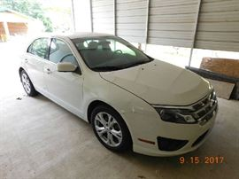 2012 Ford Fusion 27,928 miles.