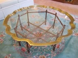 BRASS AND GLASS COFFEE TABLE    RUG IS NFS