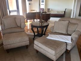 Pair of Club Chairs and Matching Ottomans with Round Side Table