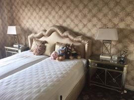 Bed with Upholstered Headboard, Pair of Mirrored Night Stands and Matching Lamps, Small Clock and Decorative