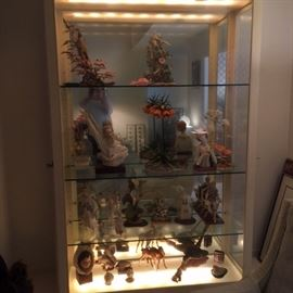 Custom-made lighted laminate Display Cabinet filled with Boehm and Cybis porcelain Figurines.