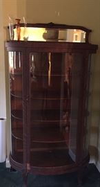 Oak China cabinet with claw feet