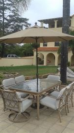 """Attractive Patio Table with 6 Chairs, Umbrella and Base. Asking Price $275 (Measures 65"""" Long/42"""" Wide/29"""" Tall)"""