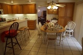 Family room table with six chair, stools, and little decoratives