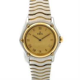 """Ebel 18K Yellow Gold and Stainless Steel Wristwatch: A Ebel 18K yellow gold and stainless steel wristwatch. This watch features a silver and gold tone stainless steel band leading to a circular case housing a gold tone dial with gold tone Roman numeral hour indicators, slender gold tone hands, and imprinted with """"Ebel Swiss Made."""""""