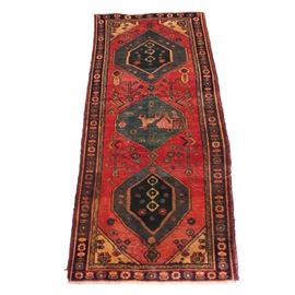 Antique Hand-Knotted Persian Tabriz Pictorial Carpet Runner: An antique hand-knotted Persian Tabriz pictorial carpet runner. This runner displays three blue central pole medallions depicting an animal form to center. The rug has an abrashed red field compact with floral motifs throughout. The compound border features floral and vine imagery finished with brown selvedge and natural warp fringe. Unmarked.