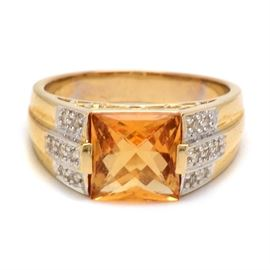 14K Yellow Gold Citrine and Diamond Ring: A 14K yellow gold citrine and diamond ring. This ring features a square citrine stone with diamonds set to the shoulders.