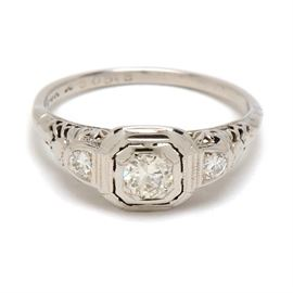Vintage 14K and 18K White Gold Diamond Ring: A vintage Art Deco style 14K white gold ring featuring an 18K white gold pierced filagree top which displays three diamonds.