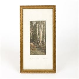 "Lawson Hand Tinted Photograph ""The Pasture Gate"": A hand tinted photograph by Lawson. Titled The Pasture Gate, this depicts a wooden gate standing underneath the shadow of tall birch trees, at the corner of a country field.This it titled below and signed ""Lawson"". The work is presented in a gold tone painted wooden frame that is wired for hanging."