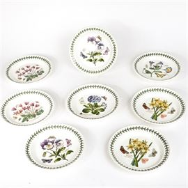 "Eight Portmeirion ""The Botanic Garden"" Bread and Butter Plates: A set of eight bread and butter plates from Portmeiron in the The Botanic Garden design, by Susan Williams-Ellis. Each plate has a colorful, detailed design of a flower to the center, marked with the scientific and common name of the species. Marked to the underside is ""Portmeiron The Botanic Garden Susan Williams-Ellis""."