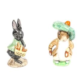 "Pair of Vintage Beatrix Potter Character Figurines: A pair of Beatrix Potter character figurines. This vintage pairing offers ""Little Black Rabbit"" by Royal Albert, and ""Benjamin Bunny"" by Beswick England. Both English made figurines show bold coloring and high gloss finishes and are marked appropriately to their undersides."