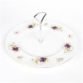 "Vintage Royal Vale Serving Plate: A vintage Royal Vale serving plate. This piece features a white round China plate with transfers of white and violet colored pansies, gilt rim, and silver toned central handle.The underside is marked ""Royal Vale, Made in England""."